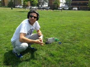 Stephen Dubner recording at an ultimate frisbee game.